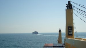 Seafaring: Front view of a cargo ship on the sea